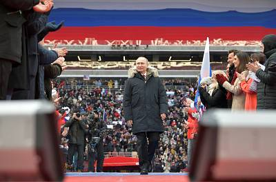 Russian President Vladimir Putin arrives to take part in a rally to support his bid in the upcoming presidential election, at Luzhniki Stadium on March 3, 2018 in Moscow.
