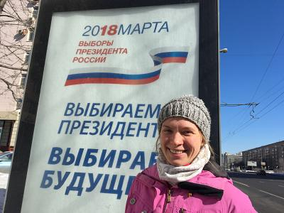 Anna Popova, 31, next to an election billboard on Kutuzovsky Avenue in central Moscow, Russia on March 18, 2018.