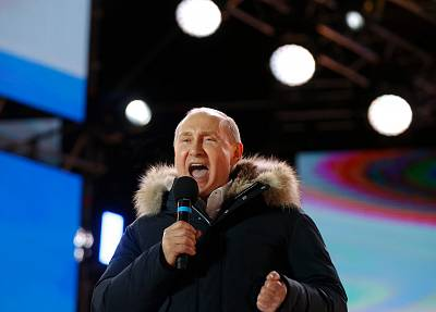 Vladimir Putin addresses the crowd during a rally and a concert celebrating the fourth anniversary of Russia\'s annexation of Crimea at Manezhnaya Square in Moscow on March 18, 2018.