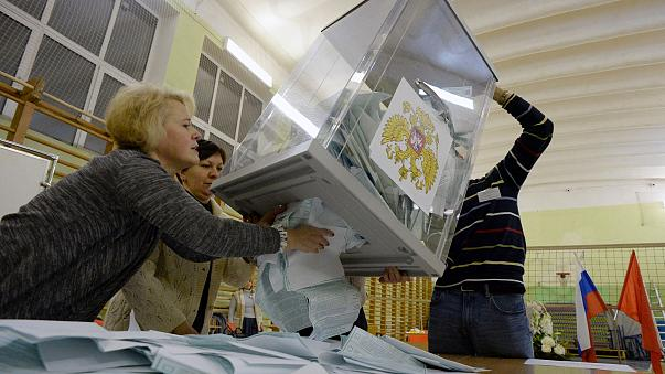 Image: Members of a local election commission empty a ballot box