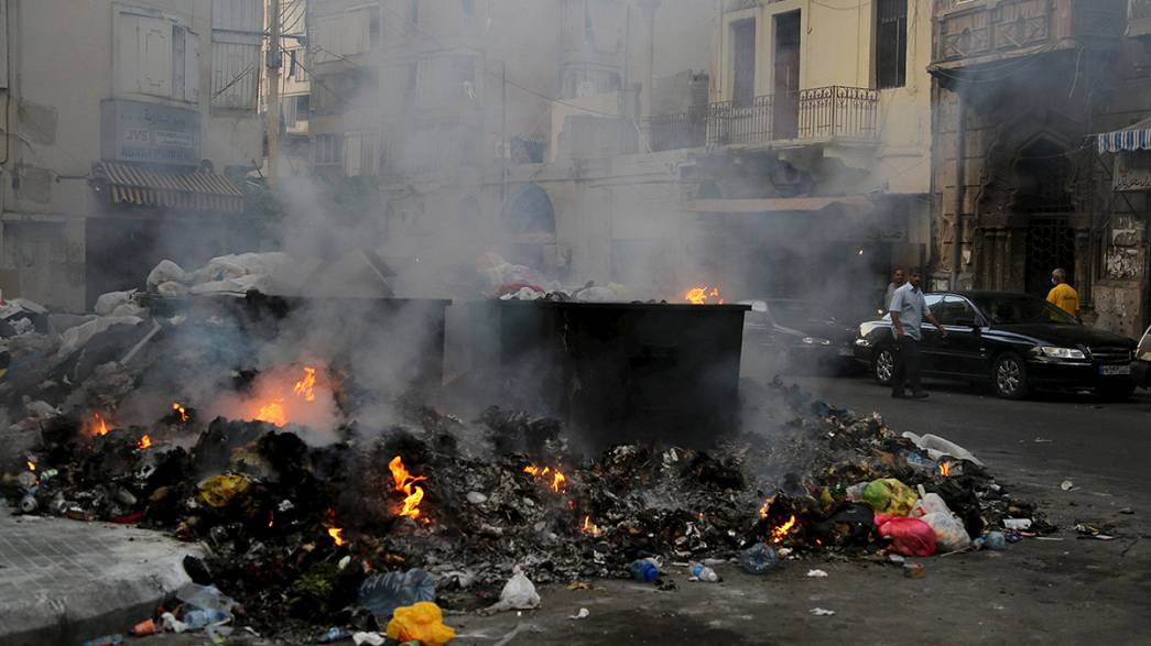 [Watch] Rubbish crisis forces residents to wear face masks in Beirut