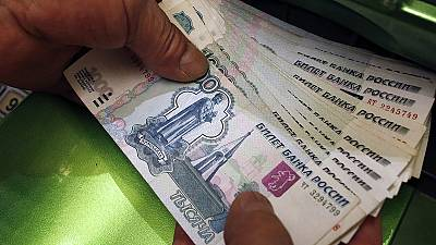 Troubled rouble hit by oil price