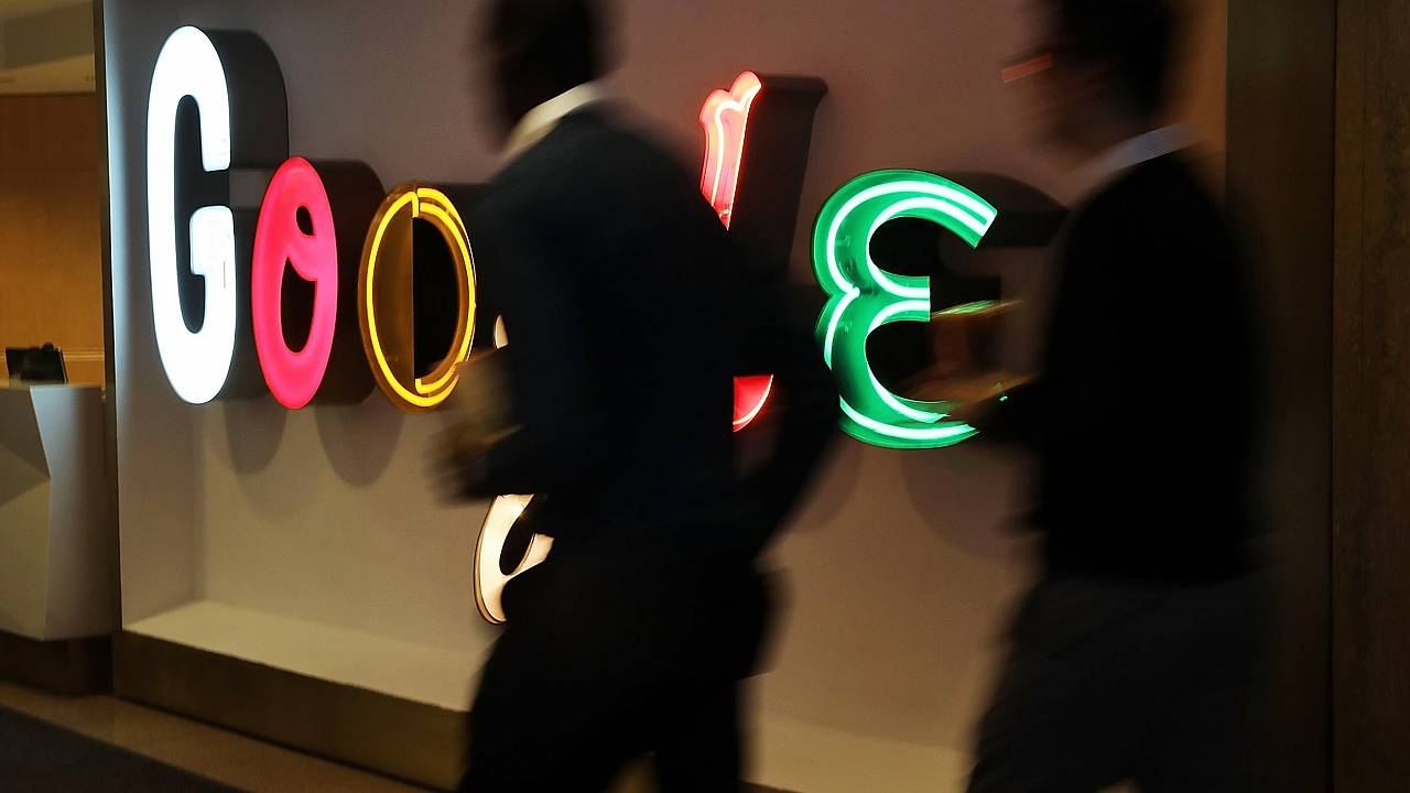 Image: People walk into Google's New York offices