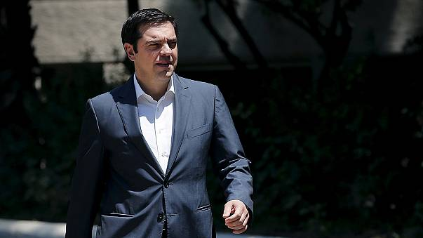 Greek PM attempts to keep his government together as new bailout talks begin