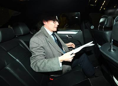 Alexander Nix, CEO of the London-based political consulting firm \'Cambridge Analytica\' leaves his offices through the back door in London, Britain on March 20, 2018.