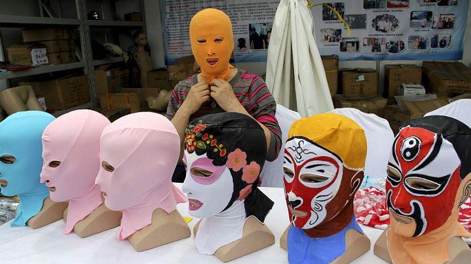 """Çinli kadınların bronzlaşma korkusu: """"Facekini"""""""