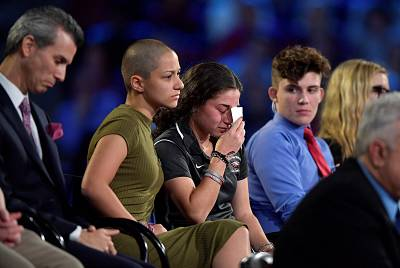 Marjory Stoneman Douglas High School student Emma Gonzalez comforts a classmate during a CNN town hall meeting, at the BB and T Center, in Sunrise, Florida on Feb. 21, 2018.