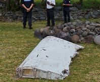 Missing MH370 flight: Plane wreckage washed up on Reunion Island is tested