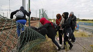 Calais migrants try their luck