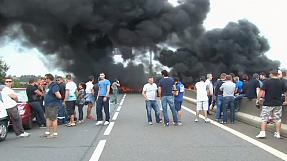 French ferry workers burn tyres to block Calais port