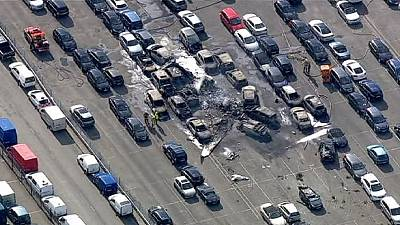 UK: Four dead as private jet crashes into car auction site