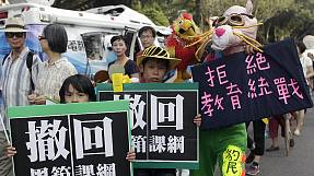 Taiwanese protesters march against controversial textbook changes