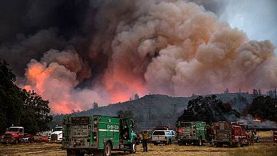 Firefighter dies as forest blazes rage across California