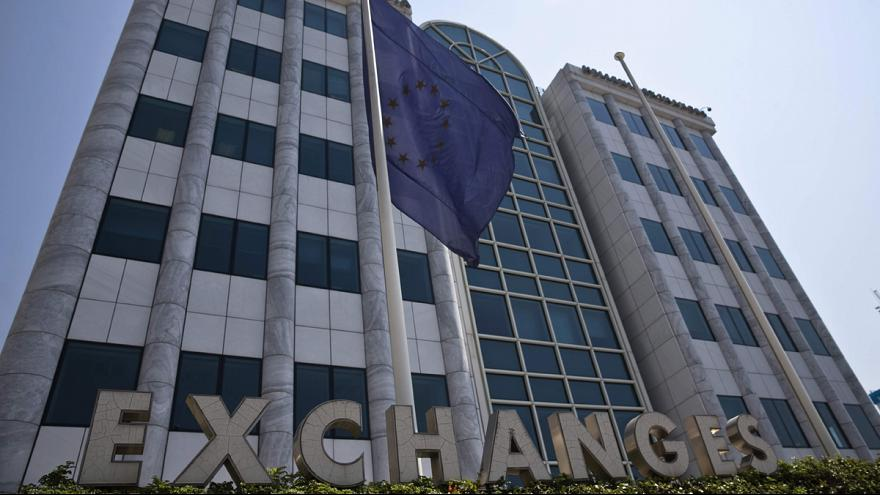 Greece's stock market re-opens almost 23% down after five-week suspension