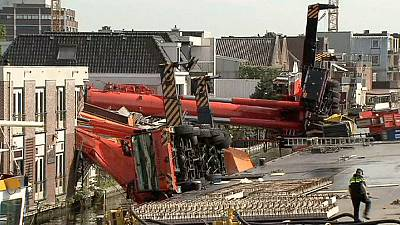 Netherlands cranes collapse on houses, dozens injured