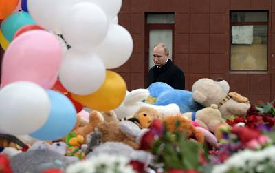 Russian President Vladimir Putin visits a memorial to victims of the shopping mall blaze.