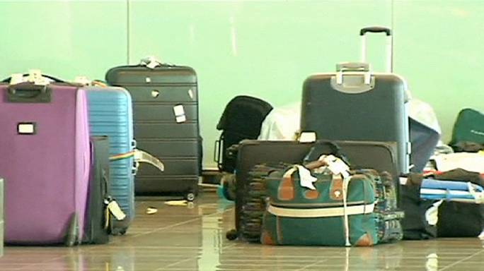 Thousands of Vueling passengers' suitcases piled up in Barcelona's El Prat airport.