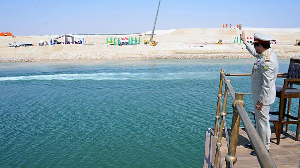 Egypt opens Suez Canal in lavish ceremony