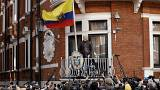 Image: WikiLeaks founder Julian Assange stands on the balcony of the Ecuado