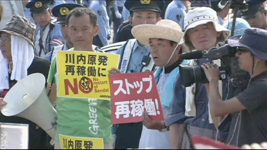 Japan switches nuclear power back on four years after Fukushima