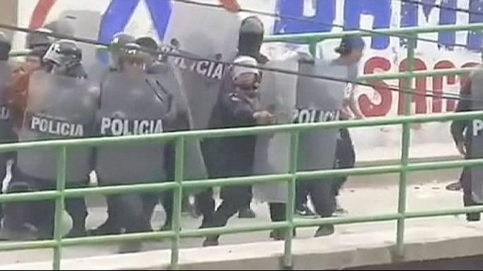 One dead and 50 hurt in clashes between police and strikers in Peru
