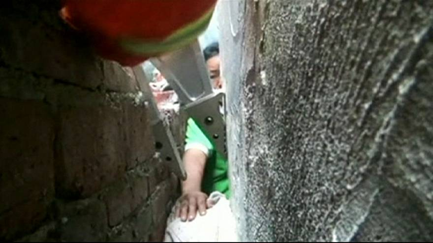 Chinese boy stuck between rock and hard place