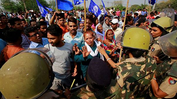 Image: Police try to stop dalit community members during a protest