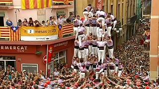 Spanish town celebrates annual 'human tower' festival