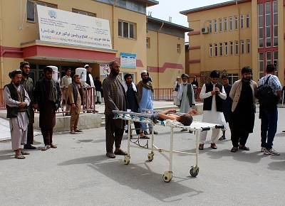 An injured boy lies on a stretcher outside a hospital in Kunduz province on Wednesday.