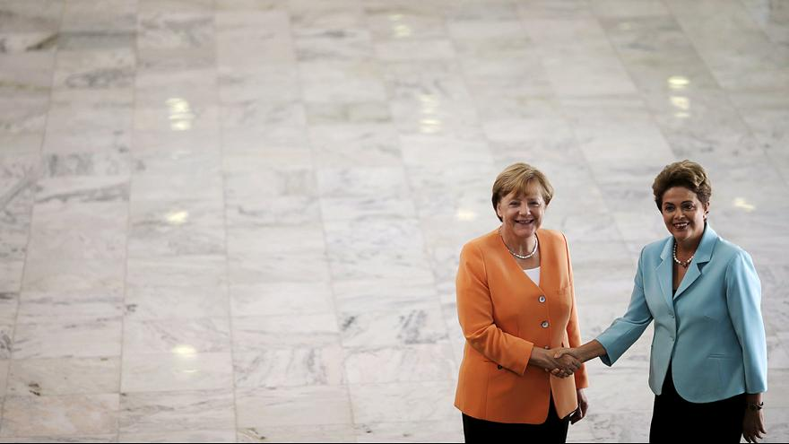 Merkel urges Brazil to open foreign competition