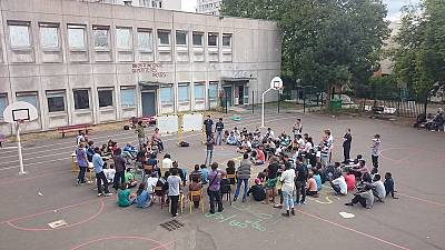 [In pictures] Paris migrants take over disused school