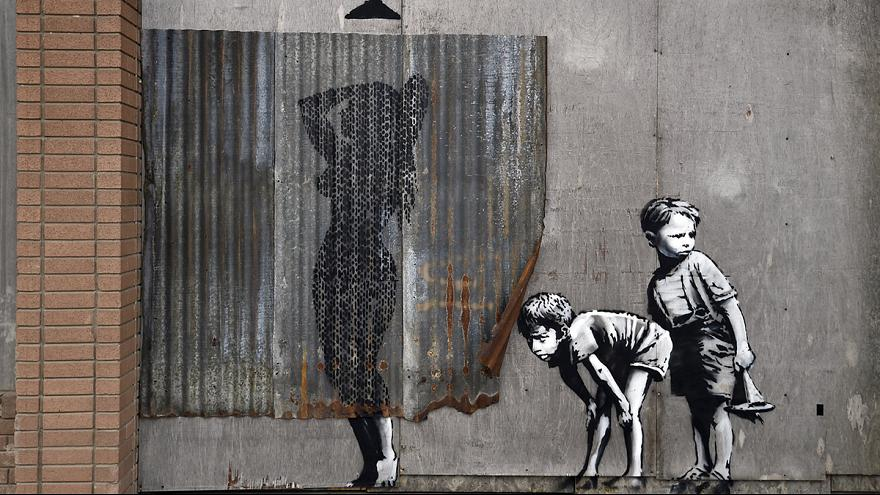 Street artist Banksy opens new Dismaland theme park in England