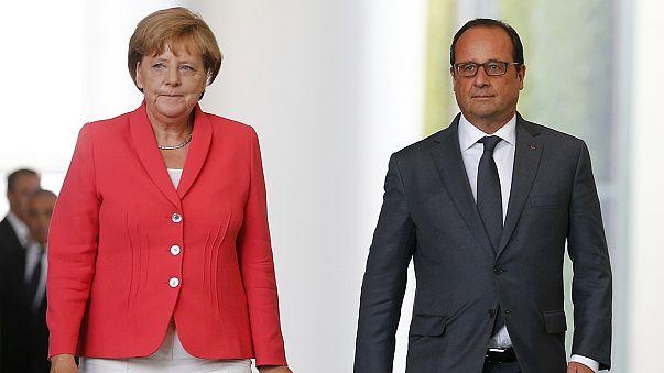 Merkel ve Hollande'dan ırkçı gösterilere kınama