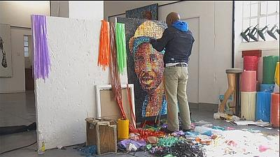 South African artist paints with fire and plastic waste