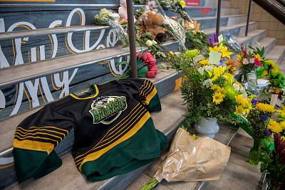 A memorial at the stairs that lead to Elgar Petersen Arena is shown in Humboldt, Saskatchewan, on April 7, 2018.