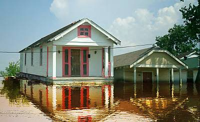 A rendering shows a house floating as floodwaters rise in the New Orleans area.