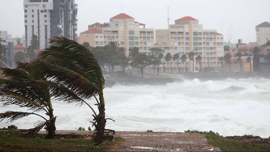 US: Erika downgraded from tropical storm, but still poses flood threat