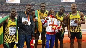 Bolt celebrates triple triumph at world championships