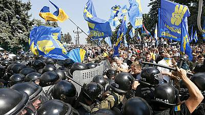Ukraine: Policeman killed and scores injured as MPs back more autonomy for the east