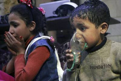 A child receiving oxygen through respirators following an alleged poison gas attack in the rebel-held town of Douma, near Damascus.