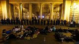 Stuck in Budapest: migrants bed down for second night outside railway station