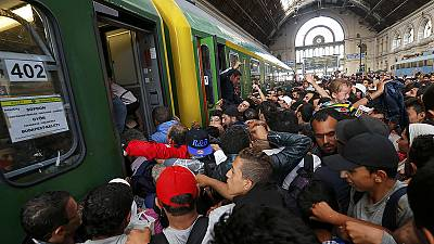 Migrants storm Budapest's main railway station