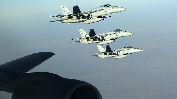 Image: A formation of U.S. Navy F-18E Super Hornets leaves after receiving