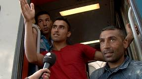 Exhausted and confused migrants board trains they hope will get them closer to Germany