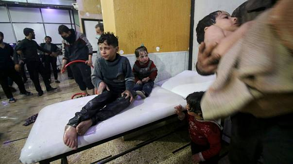 Image: Syrian kids wait to receive medical treatment after Assad regime for