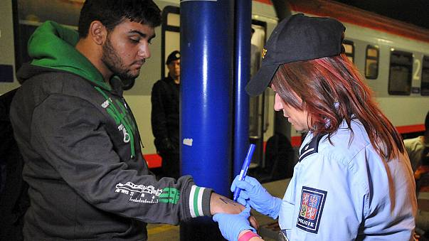 Czech police marking refugees directly on their skin