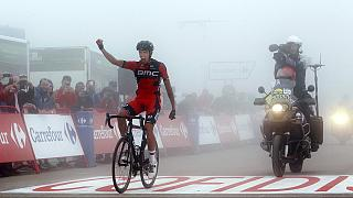 Aru retains lead in Vuelta as De Marchi claims stage 14 win