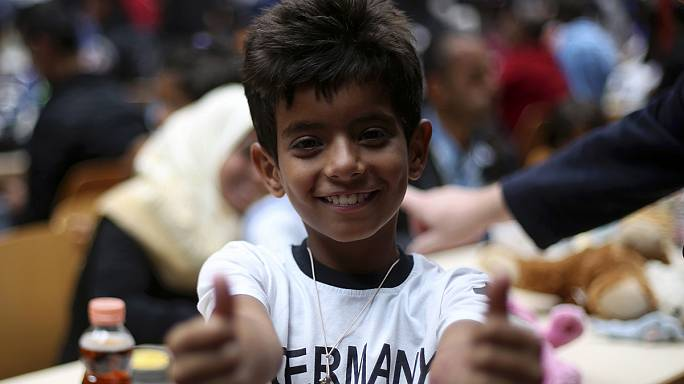 Almanya'ya ulaşan göçmenlerin yüzü gülüyor