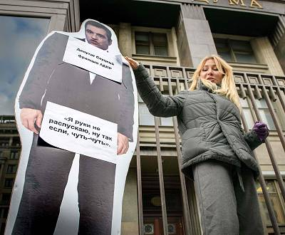 Alena Popova holds a cardboard cut of lawmaker Leonid Slutsky during a protest earlier this month.