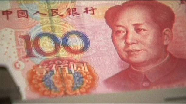 China's foreign reserves suffer biggest monthly fall on record